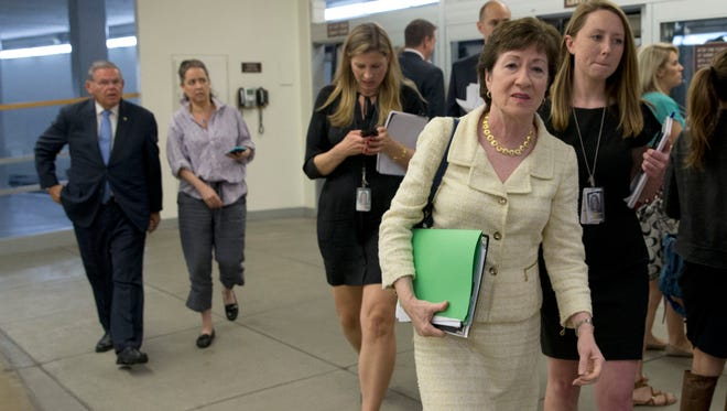 Sen. Susan Collins, R-Maine, walks toward the Senate on Capitol Hill on June 20, 2016.