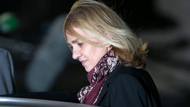 Cristina de Borbon leaves the courtroom at the Balearic School of Public Administration for summary proceedings on Jan. 11, 2016 in Palma de Mallorca, Spain. Princess Cristina of Spain, sister of King Felipe VI of Spain, faces a tax fraud trial over alleged links to business dealings of her husband, Inaki Urdangarin.