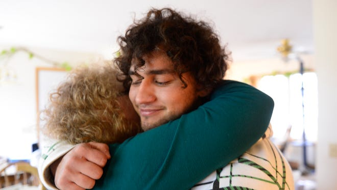 Richie Webber, 24, of Clyde hugs his mom, Cindy Weller, who has supported him through his heroin addiction and recovery.