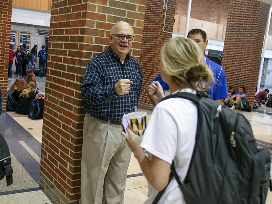 Principal John Williams welcomes students as they head to classes at Carmel High School in Carmel, Ind., Friday morning, April 21, 2017. Williams stands in the same spot every morning, for a chance to greet students and chat with teachers and staff.