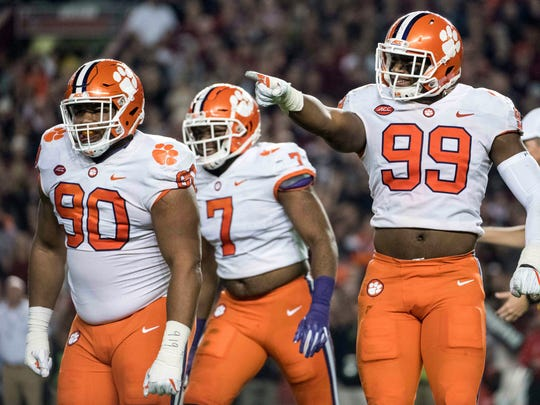 Clemson defensive end Clelin Ferrell (99), Dexter Lawrence (90) and Austin Bryant celebrate after a sack against South Carolina.