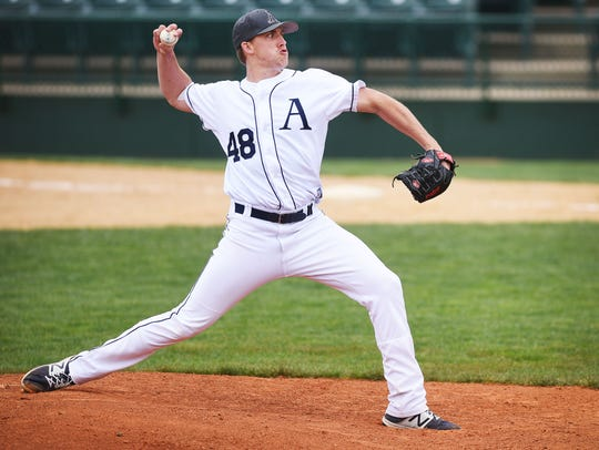 Augustana's right-handed pitcher Tyler Mitzel pitches