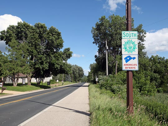 Green signs mark the Great River Road, Wisconsin's only national scenic byway.