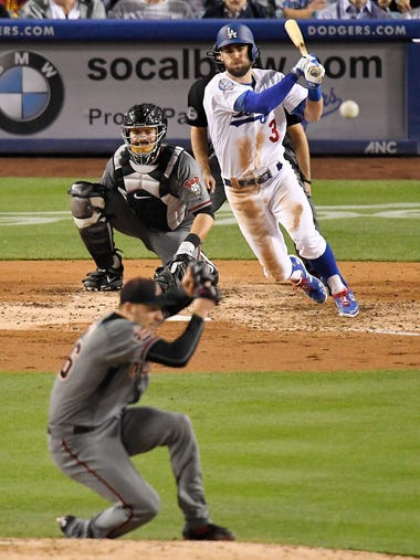 Los Angeles Dodgers' Chris Taylor watches his single