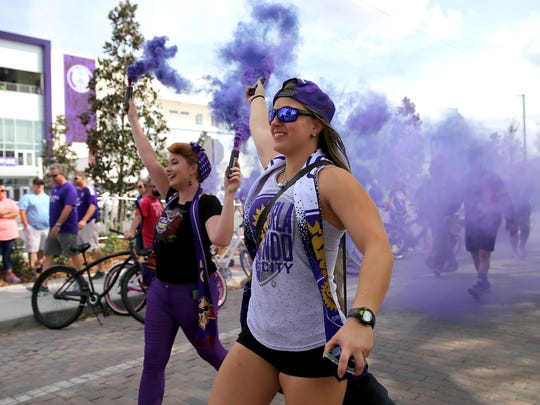 Members of the Orlando Ruckus march to the stadium prior to a MLS soccer match between New York City FC and Orlando City SC at the Orlando City Stadium on March 5, 2017 in Orlando.
