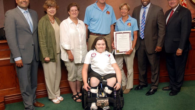 Union County Freeholder Chairman Mohamed S. Jalloh and Freeholders Sergio Granados, Bette Jane Kowalski and Angel G. Estrada present a resolution to Children's Lightening Wheels Coaches Julia Goerlich, Paul Kolterjahn and Trisha Yurochko and athlete Caitlin Goerlich congratulating the Children's Specialized Hospital team on their efforts at the Nation Junior Disabilities Championships that were held in Union County Parks in July.  The National Junior Disability Championships offers competitions in Olympic-style events including archery, powerlifting, swimming, table tennis, and track and field.