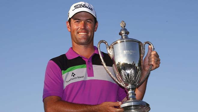 Robert Streb poses with the trophy after winning The McGladrey Classic at Sea Island's Seaside Course on Sunday. He shot a 7-under 63 and finished at 14-under 266.