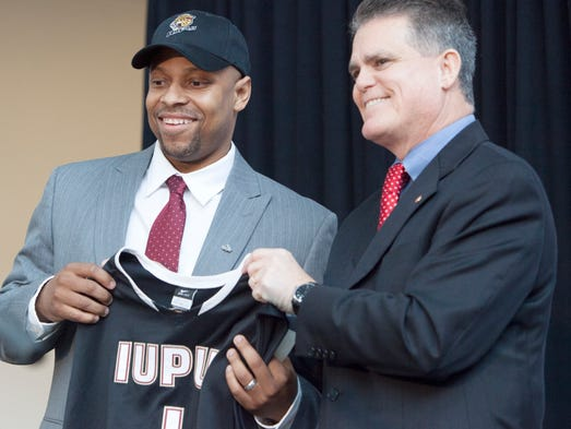 Jason Gardner poses for photographs after he is officially announced as the head basketball coach for IUPUI Wednesday, April 2, 2014.  The Former IndyStar Mr. Basketball attended North Central High School and was All American at Arizona.