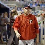 In this photo taken Sept. 13, 2015, Washington Nationals manager Matt Williams walks in the dugout during a baseball game against the Miami Marlins in Miami. The Washington Nationals say they have fired Matt Williams and his coaching staff.
