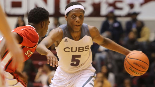 U of D Jesuit's Cassius Winston drives against Orchard Lake St. Mary's during the Catholic League championship game at Calihan Hall on March 1, 2015.