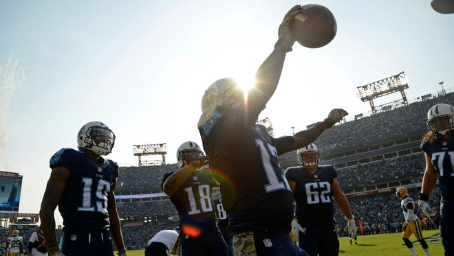 Titans wide receiver Kendall Wright (13) celebrates in the end zone after scoring a touchdown at Nissan Stadium Sunday, Nov. 13, 2016, in Nashville, Tenn.