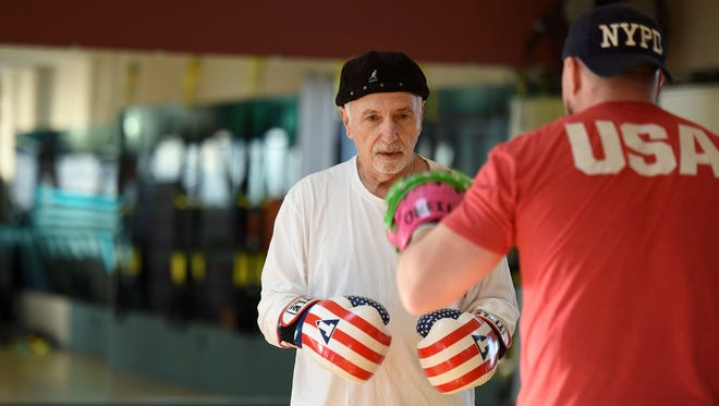Not one to be slowed down by his Parkinson's disease, Howie Kule, 74, of Upper Saddle River trains with Ron O'Neill of Park Ridge at Westwood Health & Fitness. Kule befriended O'Neill, a former NYPD police officer and semi-pro wrestler, at the gym and the two box together four times a week.