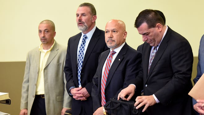 From left, Paterson DPW supervisor Imad Mowaswes with his attorney, Joseph Afflitto, and Paterson Mayor Joey Torres with his attorney, John Azzarello, at a previous hearing in Jersey City.