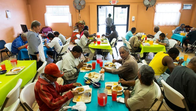 People enjoy lunch at Guadalupe Social Services during a point-in-time homeless survey on Thursday, Jan. 26, 2017, in Immokalee. The Hunger and Homeless Coalition of Collier County surveyed people in Naples and Immokalee at soup kitchens, social service locations and on the streets to provide an estimate of the numbers and characteristics of individuals and families who are homeless or at risk of becoming homeless.