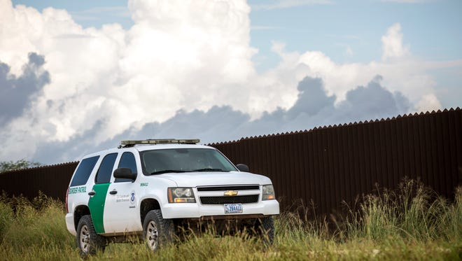 Border Patrol vehicles beside the border wall in Brownsville, Texas, on Aug. 10, 2017.