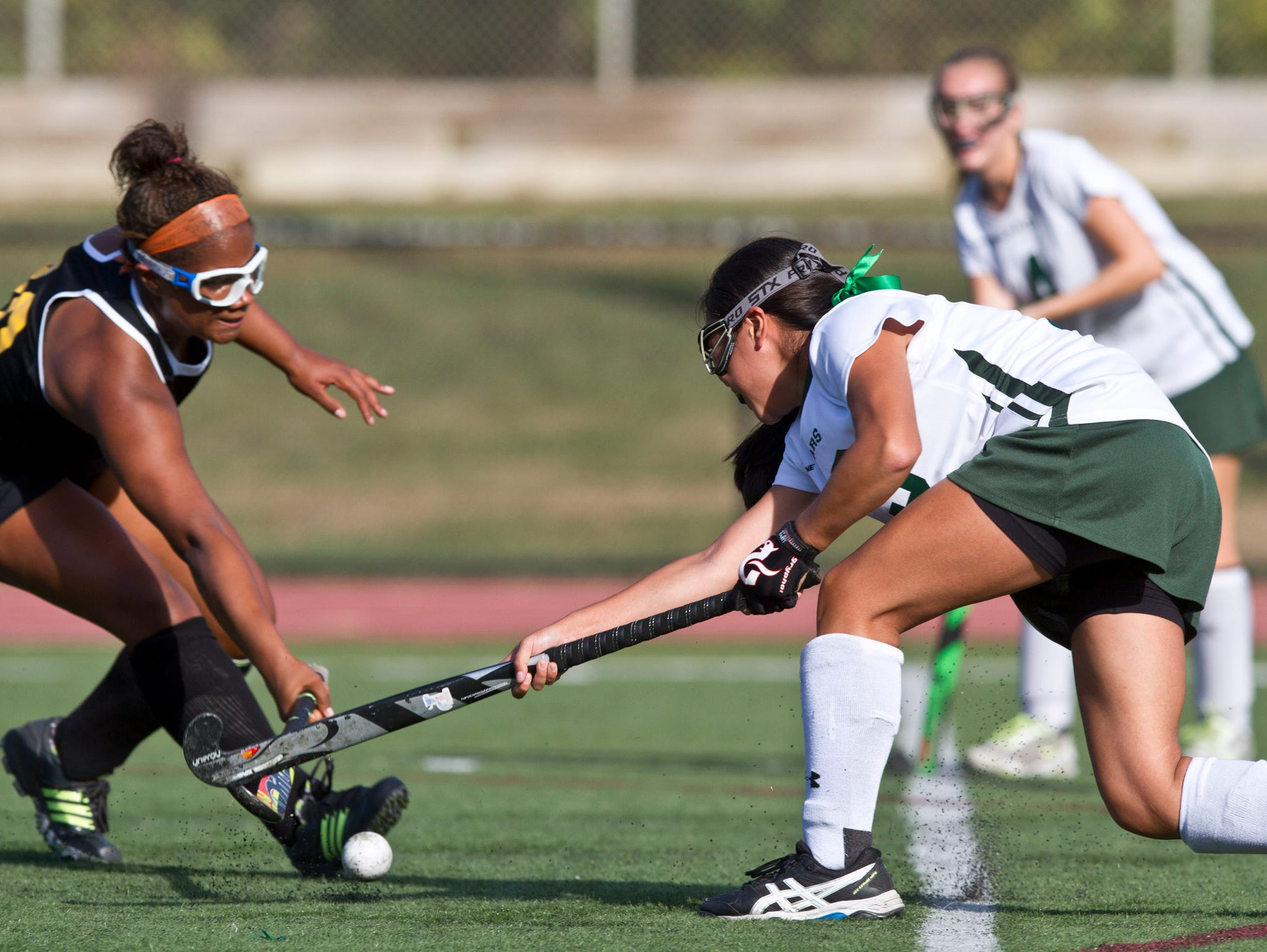 Piscataway's Asia Buffalo defends against a shot on goal by East Brunswick's Sydney Huang. Piscataway vs East Brunswick field hockey. 72670492 East Brunswick, NJ Thursday, September 24, 2015 @dhoodhood