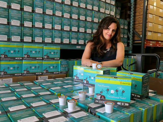 Lara Gottlieb Nikola, president of Smart Sips Coffee, an online business which delivers different flavors of coffee to customers, poses in the company's warehouse in Brick, NJ Monday, June 26, 2017.