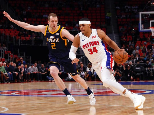 Pistons forward Tobias Harris (34) dribbles defended