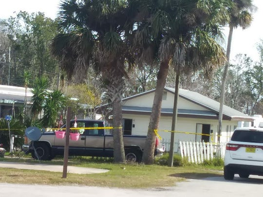 Crime scene tape was seen in the Intercoastal Estates