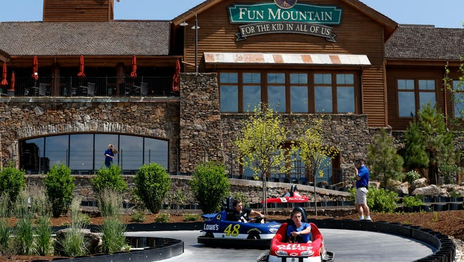 Kids from Boys and Girls Club of the Ozarks drive go-karts on a new track at Big Cedar Lodge designed by NASCAR driver Martin Truex Jr.