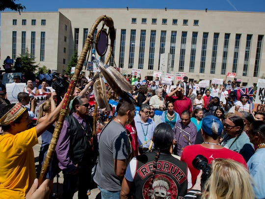 Native Americans participate in a rally outside the