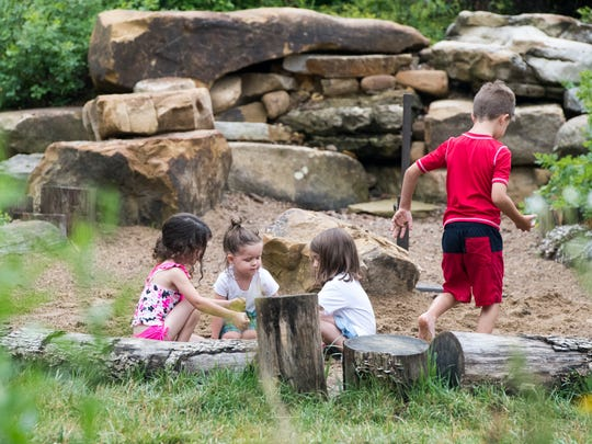 Kids play in the sandpit at Wesselman's Nature PlayScape on Tuesday, June 12. The playscape took four years to develop, design and construct and is the largest in the country.
