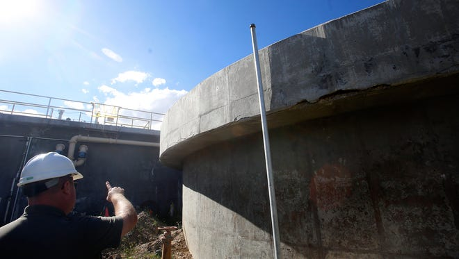 Dave Sonnenberg, a city of Bloomfield Water Reclamation Facility operations foreman, talks Monday about repairs needed on the facility's settling tanks.