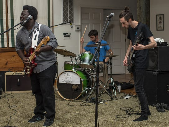 Guitarist Jeffrey Attakorah (left) performing with Newark blues trio The Blues Reincarnation Project. Attakorah will perform at the 2018 Riverfront Blues Festival on August 4.
