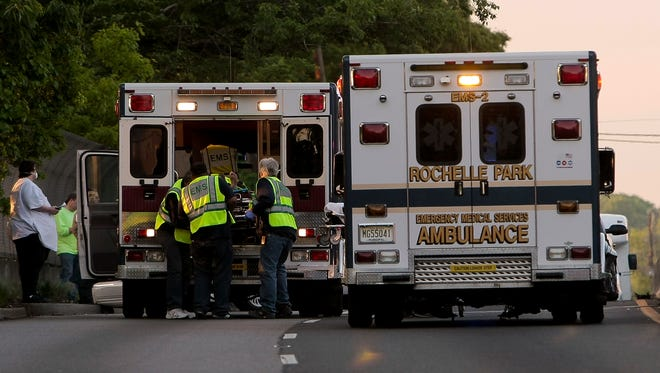 An injured person is loaded onto an ambulance  on Rt.17 south in Rochelle Park on May 6, 2012.