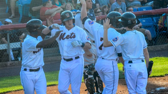 Binghamton Mets third baseman Dustin Lawley celebrates with his teammates after hitting a three-run home run during Thursday's baseball game against the Trenton Thunder at NYSEG Stadium.