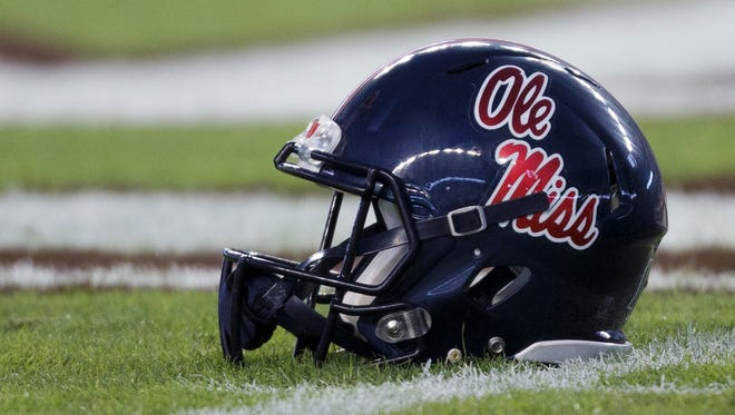 A Ole Miss' player's helmet sits near the 50 yard line on Kyle Field before the start of an NCAA college football game against Texas A&M Saturday, Nov. 12, 2016, in College Station, Texas. (AP Photo/Sam Craft)