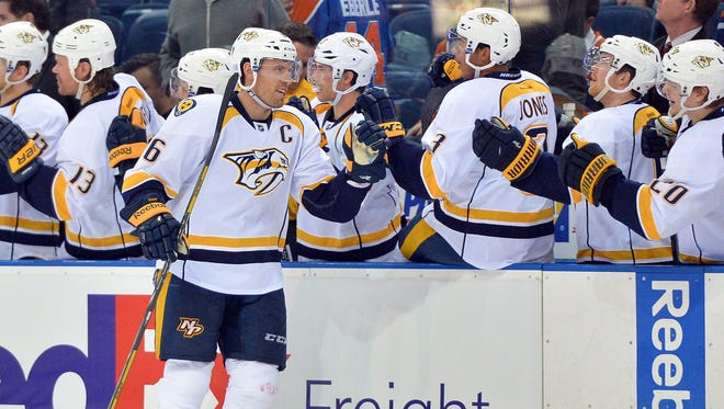 Nashville Predators defenseman Shea Weber (6) is congratulated by teammates after scoring against the Edmonton Oilers at Rexall Place.