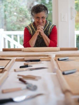 Jolynn Deloach pauses during handmade pasta-making demonstration at her home in Merchantville.
