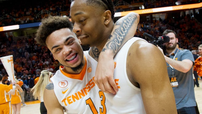 Tennessee's Lamonte Turner celebrates Robert Hubbs III after beating Alabama at Thompson-Boling Arena on Saturday to conclude the regular season. The Vols trailed by as many as 16 points in the second half but won the game 59-54.