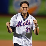 In this Oct. 30, 2015 file photo, former New York Mets' Mike Piazza throws out the first pitch before Game 3 of the Major League Baseball World Series against the Kansas City Royals, in New York.