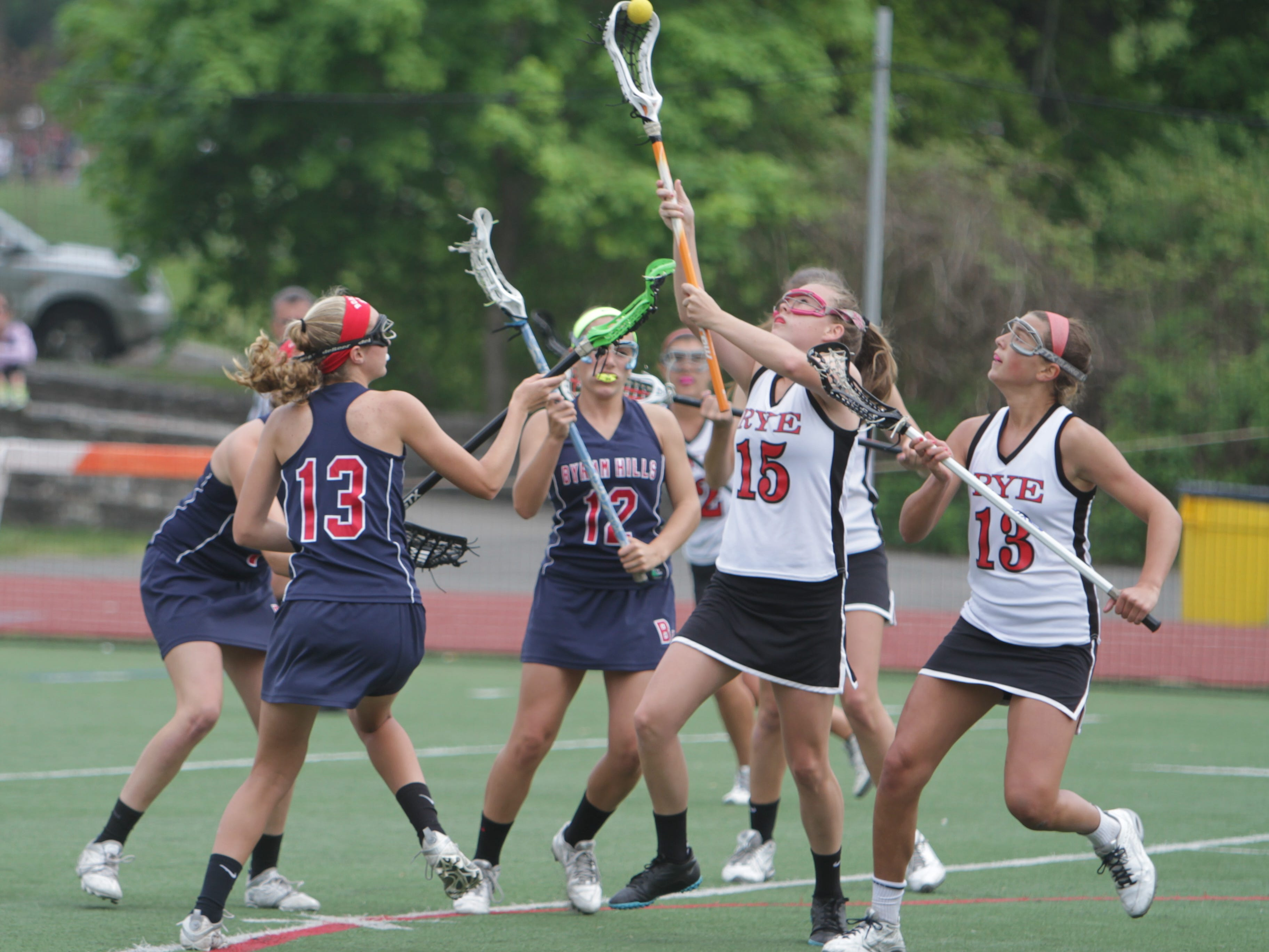 Rye's Caroline Hyland (15) attempts to reach a loose ball during a Class B quarterfinal game against visiting Byram Hills. Rye won 14-10.