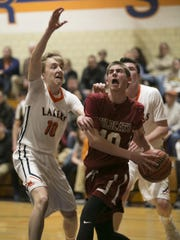 Whippany Park junior forward Nick DiJoseph (right) drives to the basket as Mountain Lakes senior Jack Albregts closes in.