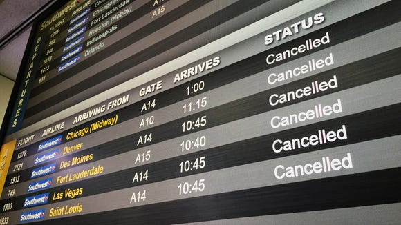A Southwest Airlines flight information screen at Newark Liberty International Airport shows canceled flights on Tuesday, March 20, 2018.