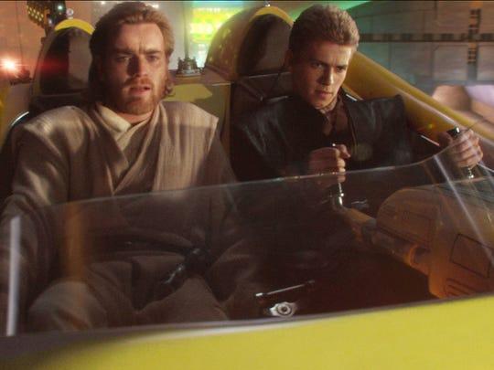 Оби-Ван Кеноби (Юэн МакГрегор) и Энакин Скайуокер (Хайден Кристенсен) охотятся за головами в