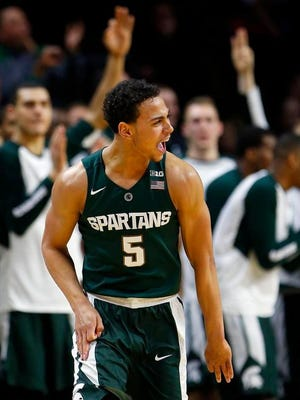 Michigan State guard Bryn Forbes (5) reacts after making a three point shot against Rutgers Scarlet Knights during second half at Louis Brown Athletic Center. Michigan State Spartans defeated Rutgers Scarlet Knights 97-66.