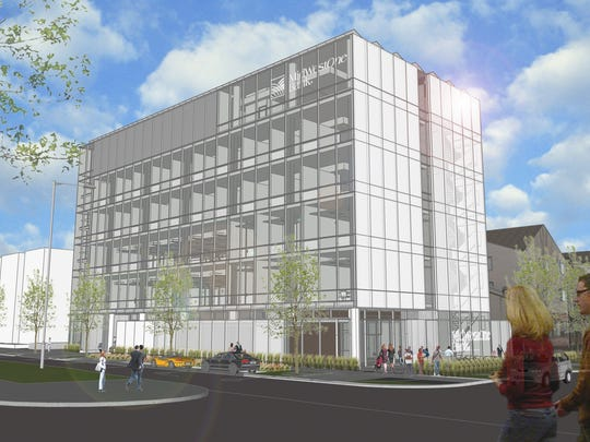 An architect's rendering shows the new MidWestOne home loan building set to open in March 2015 at the corner of East Harrison and South Clinton streets in Iowa City. Excavation work is complete at the site.