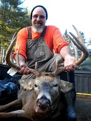 Monty Mouillesseaux, of Spencer, shows off a monster buck he tagged.