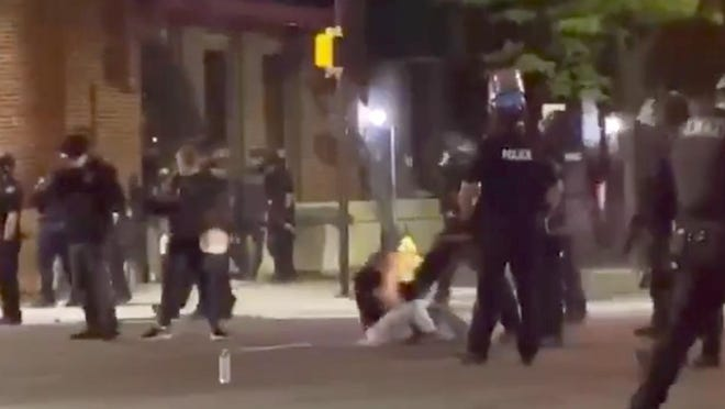 This is a screen grab of a video of Hannah Silbaugh, 21, of Erie, being kicked by an Erie Bureau of Police officer at the intersection of North Park Row and State Street in Erie on Saturday during a protest against the death of George Floyd in Minneapolis on May 25.