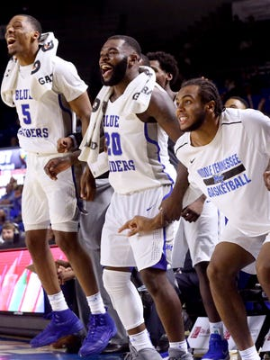MTSUÕs bench (L to R) Nick King (5), Giddy Potts (20) and TJ Massenburg (15) react from the bench in the final minutes of the game against UAB on Saturday, Feb. 24, 2018, at MTSU.