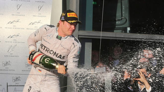 Mercedes driver Nico Rosberg of Germany sprays champagne in celebration after winning the Australian Formula One Grand Prix at Albert Park in Melbourne, Australia.