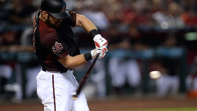 Arizona Diamondbacks right fielder Steven Souza Jr. (28) hits an RBI single against the Colorado Rockies during the fourth inning at Chase Field.