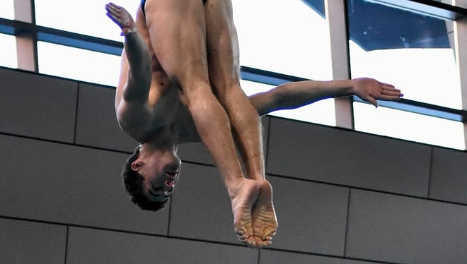 Noah Vigran of Indian Hill shows his 1st place diving skills at the Southwest Ohio Swimming and Diving Classic, Jan. 14, 2018.