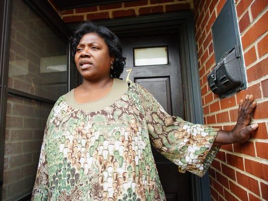 Carmen Hall recalls hearing gunfire outside her home