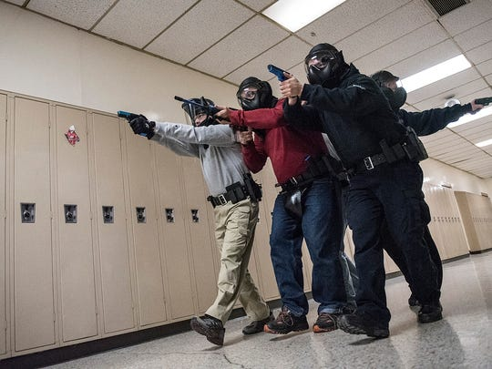 Officers run a scenario of a possible shooter, moving though the third floor halls of the PARC.