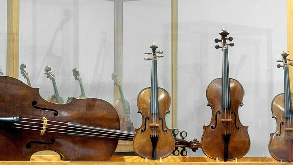 The four-piece Andrea Amati stringed instruments.